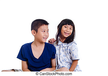 Happy Asian children isolated on white.