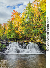 Power House Falls in Autumn - Colorful autumn leaves and a...