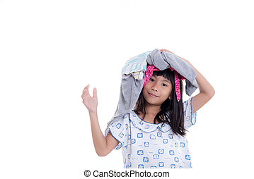 Happy little girl holding clothes on white