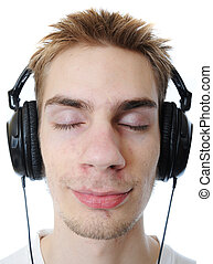 Teenager listening to music - Young adult teen listens to...