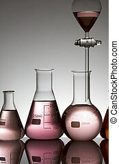 laboratory equipment with pink fluid