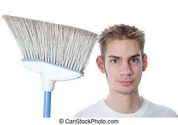 Young Janitor Smiling with Broom - Young white Caucasian...