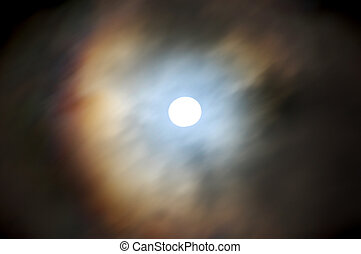 Moon with cloud coverage - Long exposure of the moon (looks...
