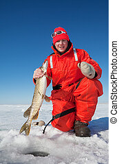 Ice fisherman - Happy ice fisherman holding a northern pike
