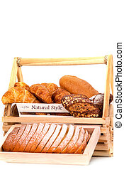 Composition with bread in basket isolated on white