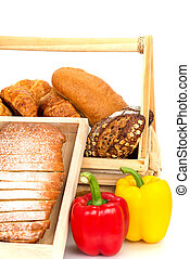 Composition with bread and vegetable in basket isolated on white