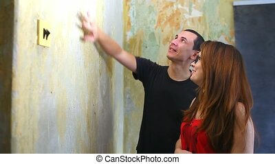woman and man working lifestyle family house painter paints wall repairs in apartment