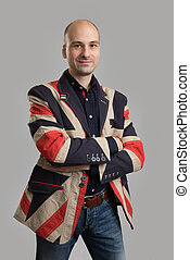 handsome bald man wearing fashionable jacket Studio shot
