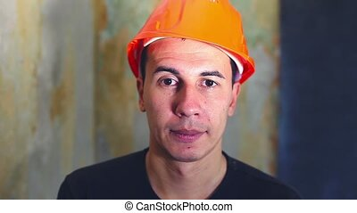 man portrait helmet construction worker in hard hat is...