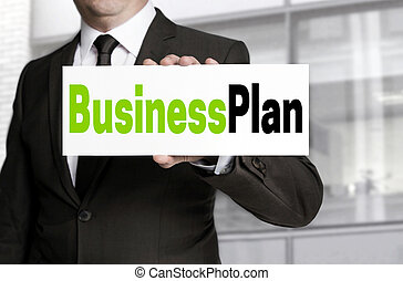 Business Plan sign is held by businessman concept