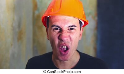 angry man architect builder in helmet swears yells...