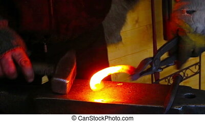 Farrier working with horse shoe in smith - Professional...