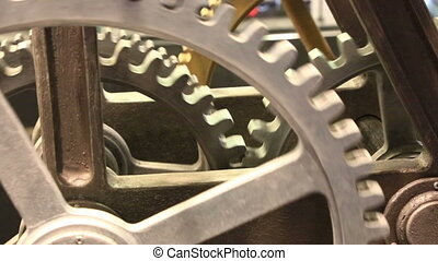 Moving gears of old mechanism close up - Close up view at...