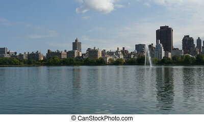New York City Central Park fountain and urban Manhattan...