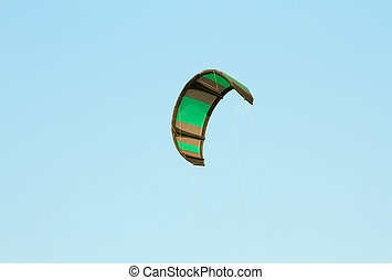 The kitesurf wing over blue sky at sunny day