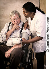 Blood pressure measuring - Nurse measuring blood pressure of...