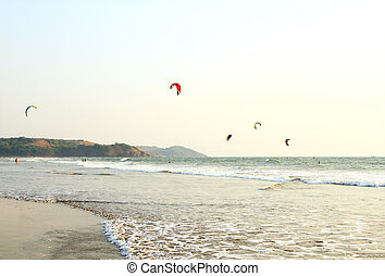 People ride on Kitesurf at sea in Goa