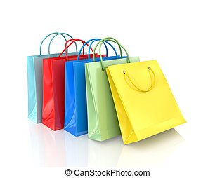 Three colorful paper bags for shopping on a white background...