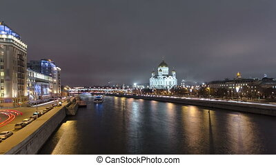 Majestic orthodox Cathedral of Christ Saviour illuminated at dusk on bank of Moscow river. Timelapse hyperlapse, Russia