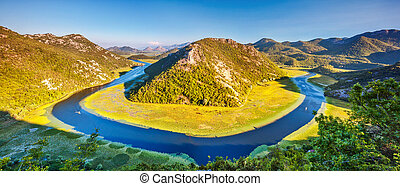 riwer in mountains - Sinuous river flowing through mountains...