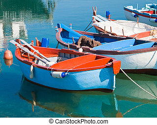 Rowboats in clear sea. - These are a colored rowboats in...