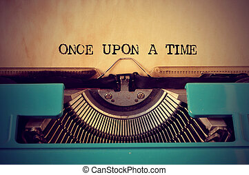 retro typewriter and text once upon a time - closeup of a...