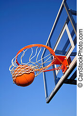 Basketball Shot Falling Through the Net, Blue Sky, vertical,...