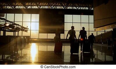 Silhouettes of travelers at the airport - Silhouettes of the...