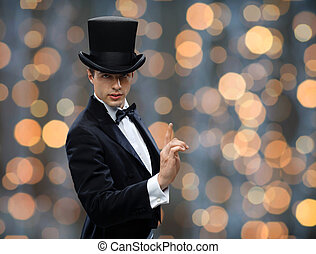 magician in top hat pointing finger up - magic, performance,...