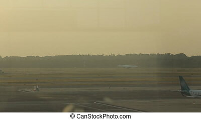 Plane takes off at the airport in Milan, view from the...