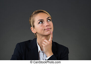 Thoughtful Young Businesswoman Looking Up