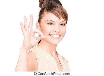 ok - bright picture of lovely woman showing ok sign