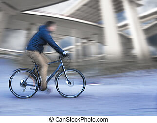 Cyclist with elevated roads - Cyclist in blurred motion with...