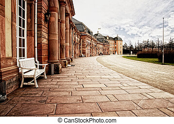 Red sandstone palace walkway with r - View of a stone tiled...