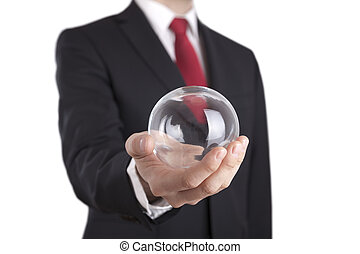 Businessman holding a glass ball isolated on white Clipping...