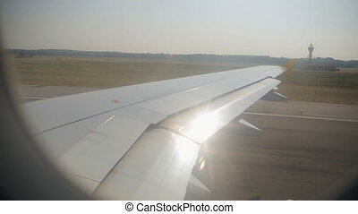 Airplane rides on the runway at the airport, view from the...