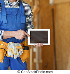 Worker using digital tablet