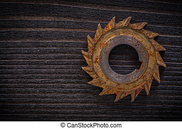 Longstanding sharp milling cutter on vintage wooden board...