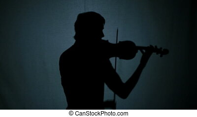 Violinist playing on violin. romantic music at sunset. -...