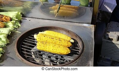 cooking corn on the grill - cooking corn cobs on the grill...