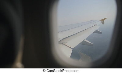View on the aircraft wing from the passenger cabin, the...