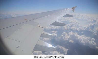 Airplane wing out of window - Airplane wing out of the...