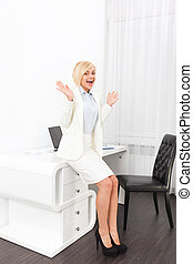 Business woman excited hold hands up raised office -...