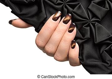 Beautiful woman's nails with nice stylish manicure.