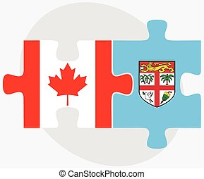 Canada and Fiji Flags in puzzle isolated on white background