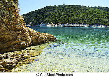 beach in Ithaca island Greece - beach with transparent green...