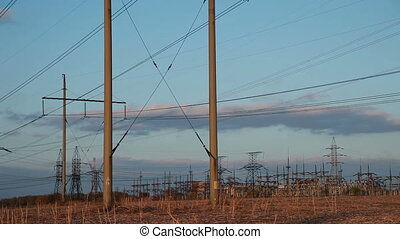High-voltage Line. Poles With Wires at Sunset.