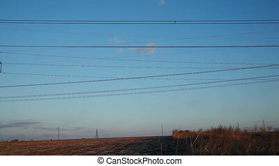 High-voltage Line Poles With Wires at Sunset