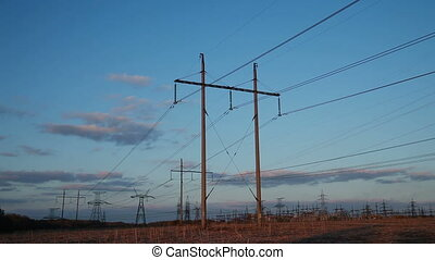 High-voltage Line. Poles With Wires at Sunset. Timelapse