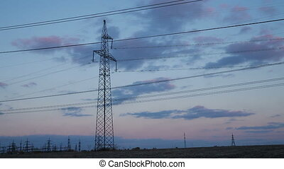 High-voltage Line Poles With Wires at Sunset Timelapse